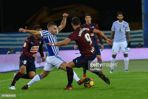 Kevin Rodrigues of Real Sociedad duels for the ball with Takashi Inui and Sergi Enrich of Eibar during the Spanish league football match between Real...