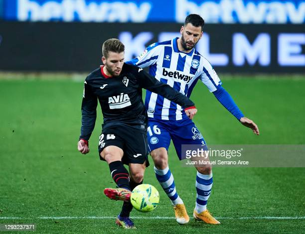 Kevin Rodrigues of SD Eibar duels for the ball with Edgar Mendez of Deportivo Alaves during the La Liga Santander match between Deportivo Alavés and...