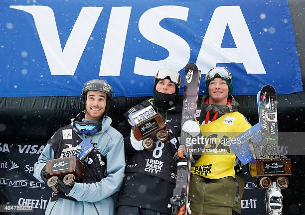 Kevin Rolland of France in second place Gus Kenworthy in first place and David Wise in third place celebrate on the podium during the FIS Freeskiing...