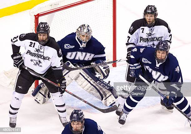 Kevin Rooney and Drew Brown both of the Providence College Friars battle against Casey DeSmith and Dylan Maller both of the New Hampshire Wildcats...