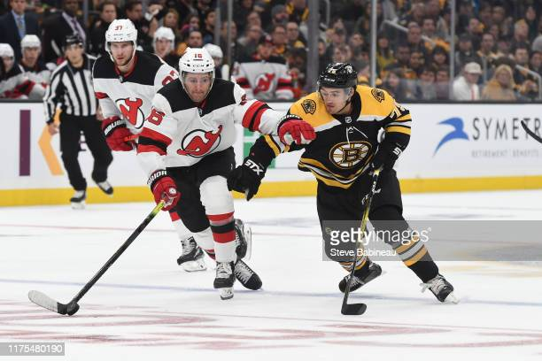 Kevin Rooney of the New Jersey Devils skates against Connor Clifton of the Boston Bruins at the TD Garden on October 13 2019 in Boston Massachusetts