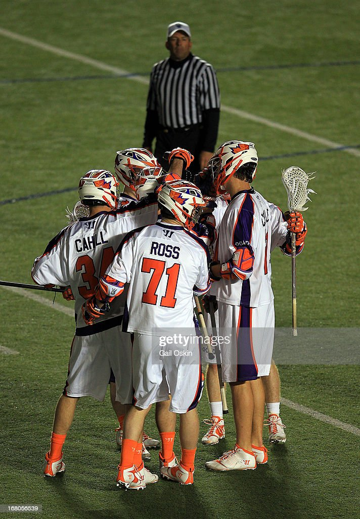 Kevin Ross #71 of the Hamilton Nationals is congratulated by his teammates for his goal in the fourth quarter in a game against the Boston Cannons at Harvard Stadium May 4, 2013 in Boston, Massachusetts. The Hamilton Nationals defeated the Boston Cannons 15-8.