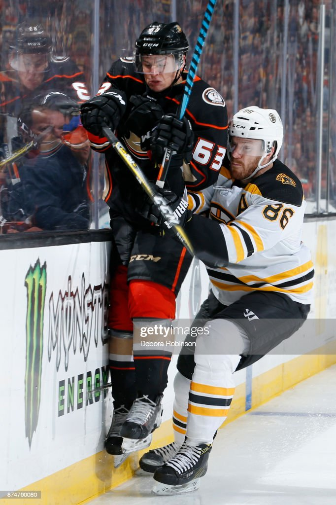 Kevin Roy #63 of the Anaheim Ducks battles for position against Kevan Miller #86 of the Boston Bruins during the game on November 15, 2017 at Honda Center in Anaheim, California.