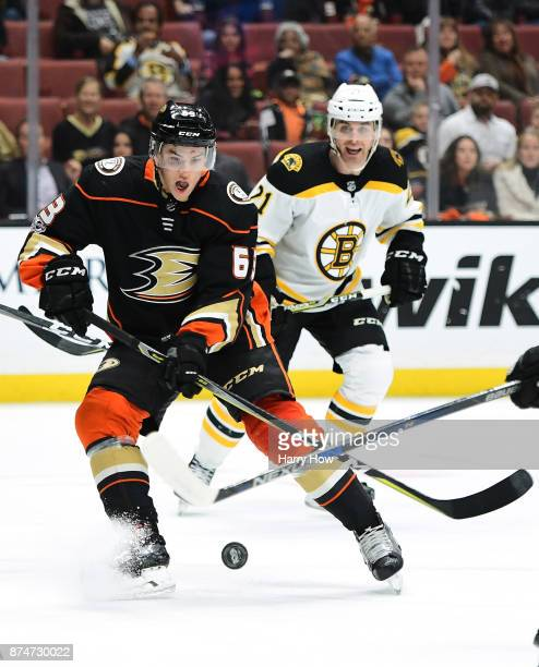 Kevin Roy of the Anaheim Ducks prepares to shoot a rolling puck for his first NHL goal in front of Jordan Szwarz the Boston Bruins to take a 10 lead...