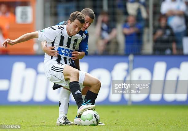 Kevin Ruiz of Aalen and Onel Diego Demme of Bielefeld fight for the ball during the Third League match between Arminia Bielefeld and VfR Ahlen at the...