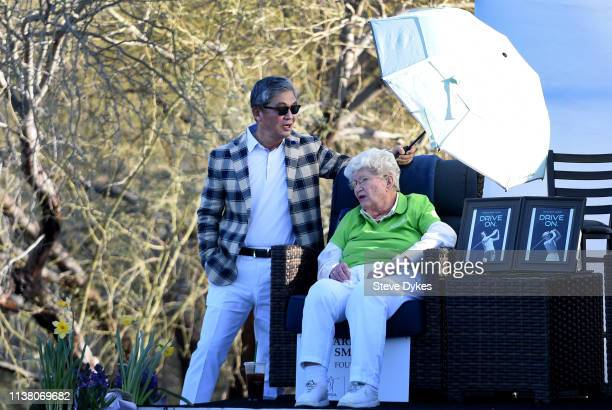 Kevin S Kim President and CEO of the Bank of Hope holds an umbrella to block the sun for LPGA Founder Marilynn Smith during the final round of the...