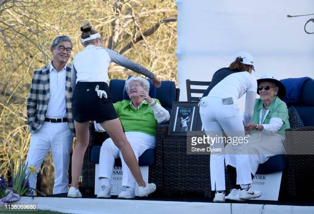 Kevin S Kim President and CEO of the Bank of Hope looks on as Nelly Korda greets LPGA Founder Marilynn Smith and Jin Young Ko of Korea greets fellow...
