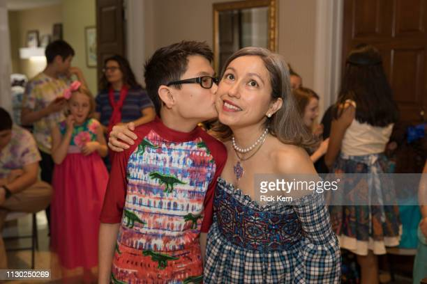 Kevin Sanders and designer Marisol Deluna attend the Marisol Deluna Foundation Community Fashion Show at the San Antonio Garden Center on February 16...