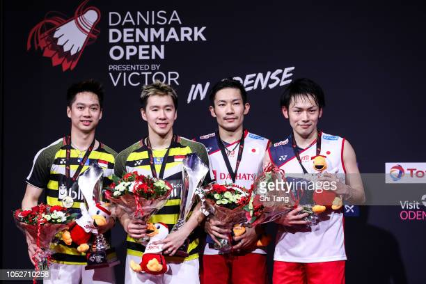 Kevin Sanjaya Sukamuljo and Marcus Fernaldi Gideon of Indonesia and Japan's Keigo Sonoda and Takeshi Kamura pose with their medals after the Men's...