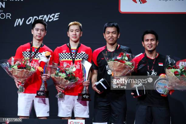 Kevin Sanjaya Sukamuljo, Marcus Fernaldi Gideon, Hendra Setiawan and Mohammad Ahsan of Indonesia pose with their trophies after the Men's Double...