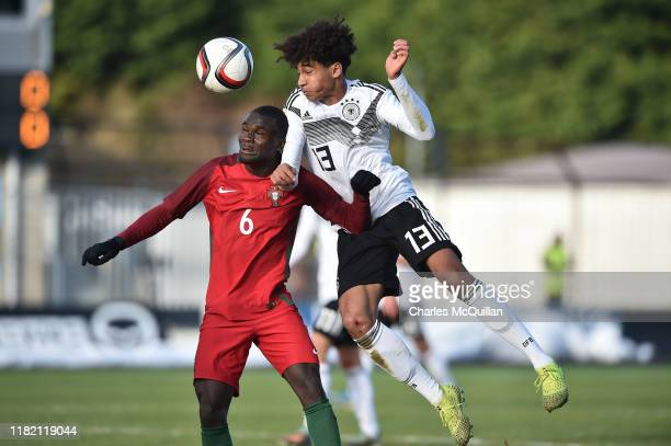Kevin Schade of Germany and Henrique Jocu of Portugal during the u19 international friendly between Germany and Portugal at the Showgrounds on...