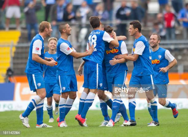 Kevin Scheidhauer of Bochum celebrates with teammates after scoring their first goal with team mates during the Second Bundesliga match betweeen SSV...