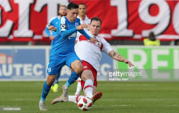Kevin Scheidhauer of Cottbus challenges for the ball with Sinan Karweina of Lotte during the 3. Liga match between FC Energie Cottbus and VfL...