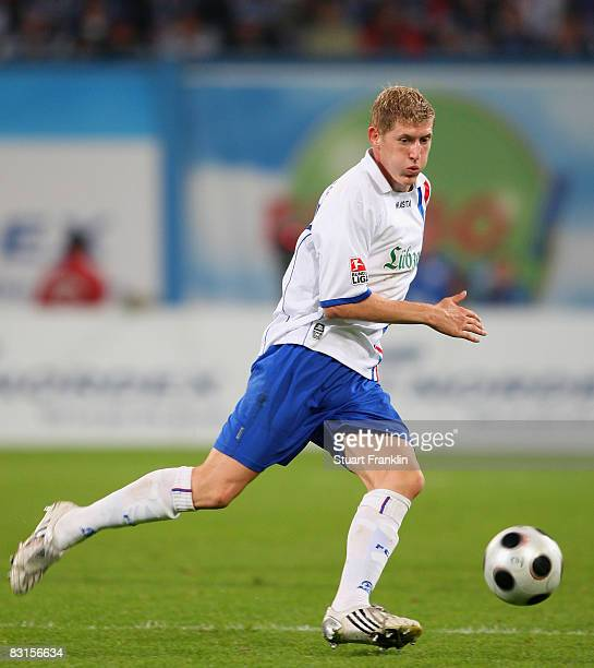 Kevin Schindler of Rostock runs with the ball during the Second Bundesliga match between FC Hansa Rostock and FC St Pauli at the DKB Arena on...