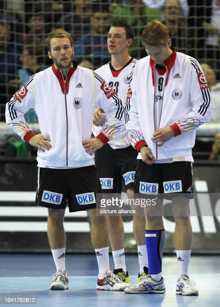 Kevin Schmidt , Dominik Klein and Tobias Reichmann of Germany react after the men's Handball World Championships quarter-final match Spain vs Germany...