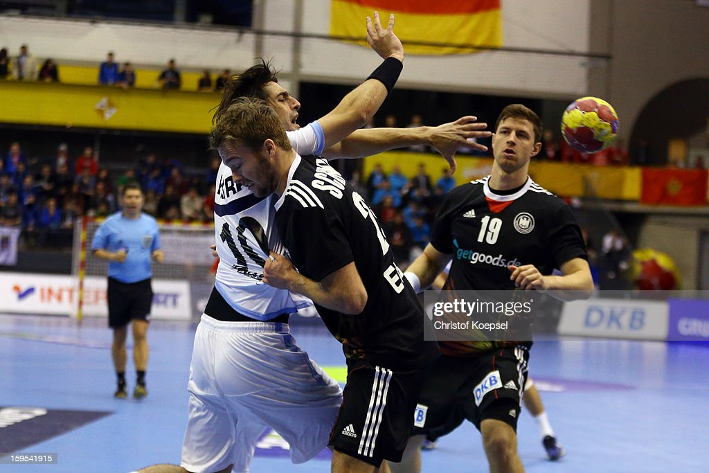 Kevin Schmidt of Germany (C) and Martin Strobel of Germany (R) defend against Frederico Vieyra of Argentina (L) during the premilary group A match between Germany and Argentina at Palacio de Deportes de Granollers on January 15, 2013 in Granollers, Spain.
