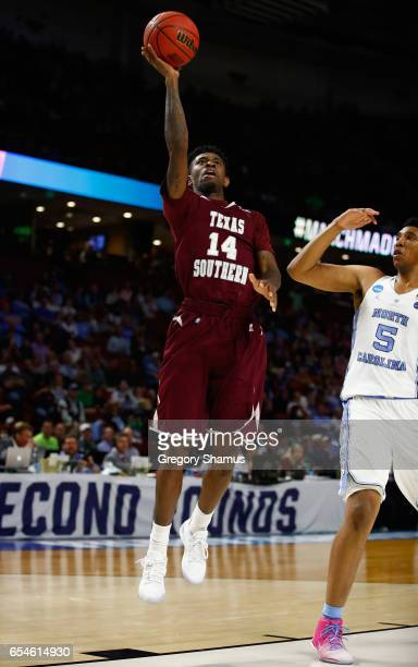 Kevin Scott of the Texas Southern Tigers shoots against Tony Bradley of the North Carolina Tar Heels in the second half during the first round of the...