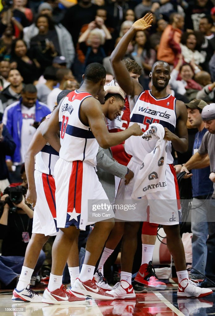 Kevin Seraphin #13 and Emeka Okafor #50 of the Washington Wizards celebrate during the closing seconds of the Wizards 101-99 win over the Oklahoma City Thunder at Verizon Center on January 7, 2013 in Washington, DC.