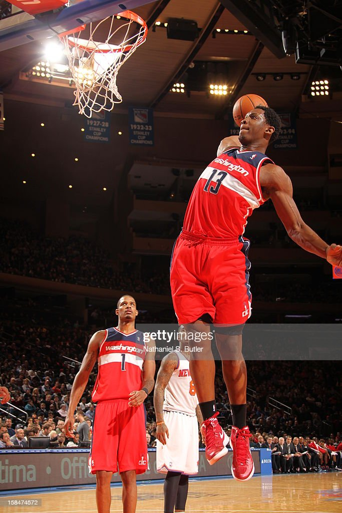 Kevin Seraphin #13 of the Washington Wizards dunks the ball against the New York Knicks on November 30 2012 at Madison Square Garden in New York City.