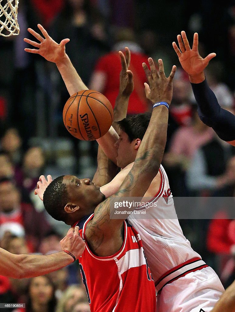 Kevin Seraphin #13 of the Washington Wizards fouls Doug McDermott #3 of the Chicago Bulls at the United Center on March 3, 2015 in Chicago, Illinois.