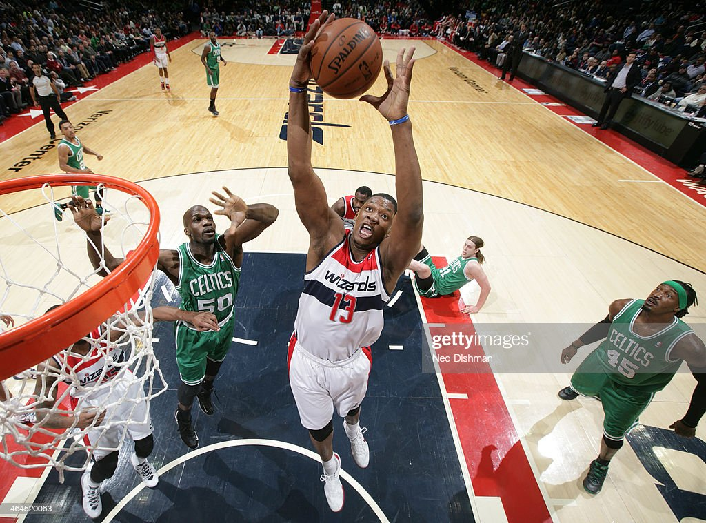 Kevin Seraphin #13 of the Washington Wizards rebounds against Joel Anthony #50 of the Boston Celtics during the game at the Verizon Center on January 22, 2014 in Washington, DC.