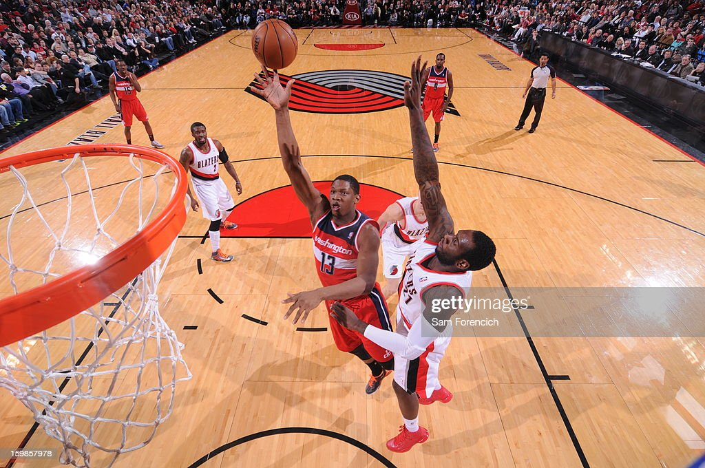 Kevin Seraphin #13 of the Washington Wizards shoots against J.J. Hickson #21 of the Portland Trail Blazers on January 21, 2013 at the Rose Garden Arena in Portland, Oregon.