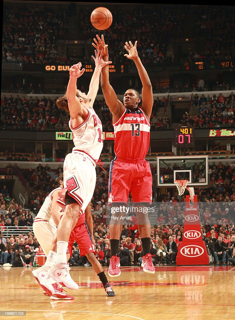 Kevin Seraphin #13 of the Washington Wizards shoots against Joakim Noah #13 of the Chicago Bulls on December 29, 2012 at the United Center in Chicago, Illinois.