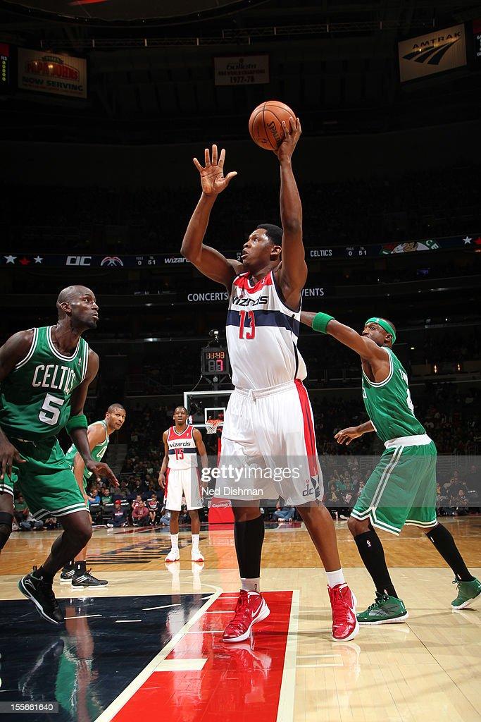 Kevin Seraphin #13 of the Washington Wizards shoots against Kevin Garnett #5 of the Boston Celtics at the Verizon Center on November 3, 2012 in Washington, DC.