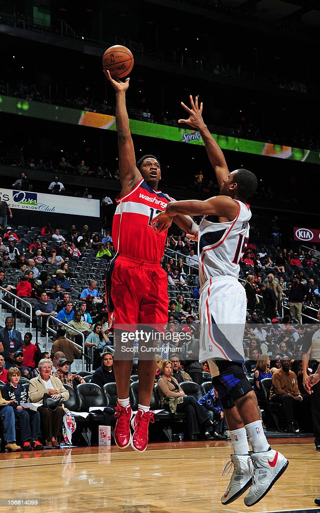 Kevin Seraphin #13 of the Washington Wizards shoots over the Atlanta Hawks at Philips Arena on November 21, 2012 in Atlanta, Georgia.