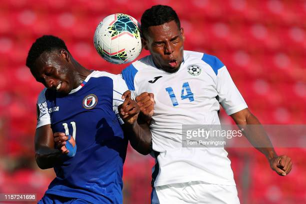 Kevin Serapio of Nicaragua heads the ball against Derrick Etienne of Haiti in the first half of the Nicaragua v Haiti Group B 2019 CONCACAF Gold Cup...