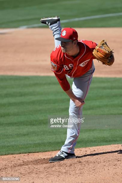Kevin Shackelford of the Cincinnati Reds delivers a pitch in the second inning against the Oakland Athletics in the spring training game at HoHoKam...