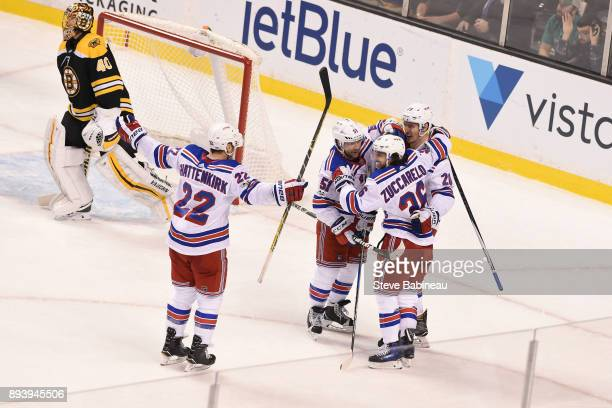 Kevin Shattenkirk David Desharnais Chris Kreider and Mats Zuccarello of the New York Rangers celebrate an overtime win against the Boston Bruins at...
