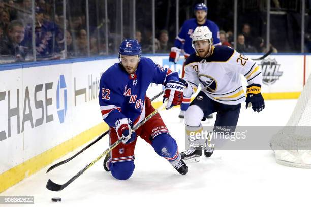 Kevin Shattenkirk of the New York Rangers and Scott Wilson of the Buffalo Sabres chase after the puck in the second period during their game at...