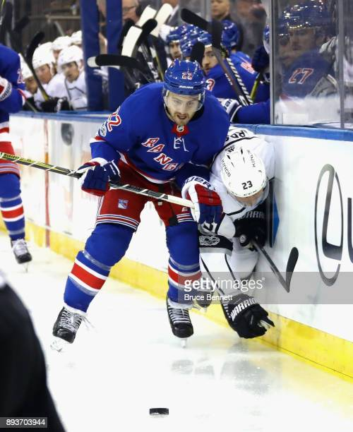 Kevin Shattenkirk of the New York Rangers checks Dustin Brown of the Los Angeles Kings into the boards during the first period at Madison Square...