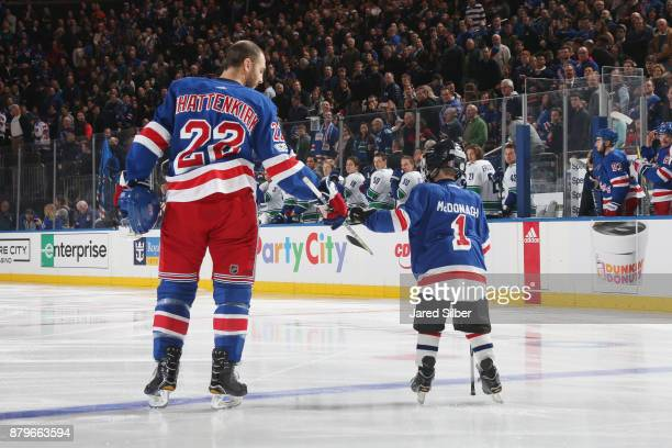 Kevin Shattenkirk of the New York Rangers greets a Junior Ranger player on the blue line for the national anthem during kids day before the game...