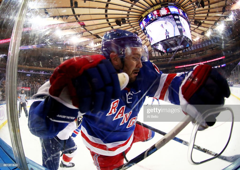 Kevin Shattenkirk #22 of the New York Rangers is checked during their game against the Florida Panthers at Madison Square Garden on November 28, 2017 in New York City.