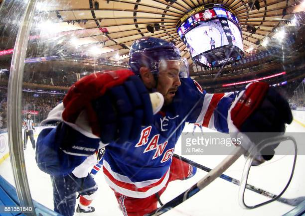 Kevin Shattenkirk of the New York Rangers is checked during their game against the Florida Panthers at Madison Square Garden on November 28 2017 in...