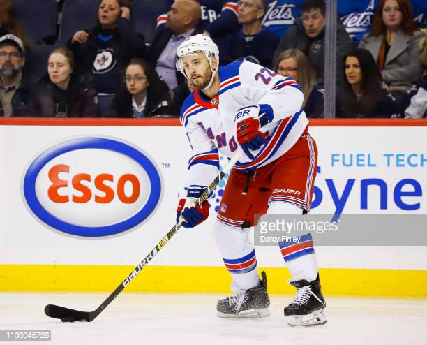 Kevin Shattenkirk of the New York Rangers plays the puck during first period action against the Winnipeg Jets at the Bell MTS Place on February 12...
