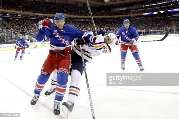 Kevin Shattenkirk of the New York Rangers shoves Darnell Nurse of the Edmonton Oilers in the third period during their game at Madison Square Garden...