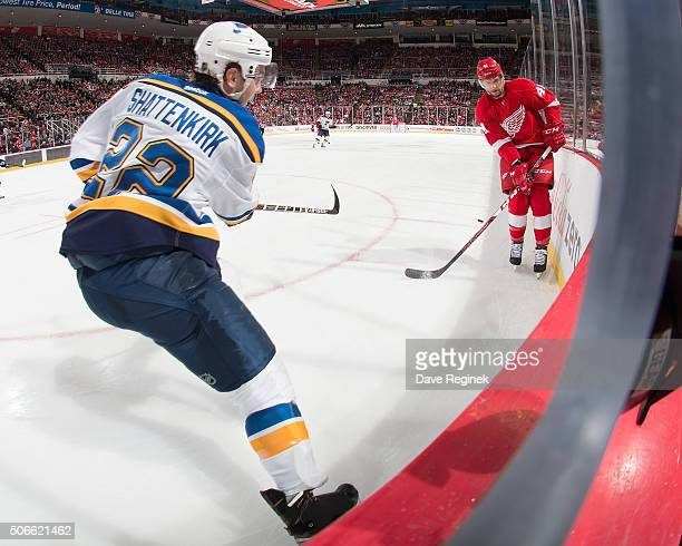 Kevin Shattenkirk of the St Louis Blues clears the puck past Luke Glendening of the Detroit Red Wings during an NHL game at Joe Louis Arena on...