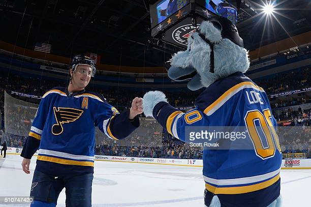 Kevin Shattenkirk of the St Louis Blues is congratulated by team mascot Louie after scoring the gamewinning goal against the Dallas Stars at the...