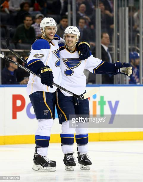 Kevin Shattenkirk of the St Louis Blues is congratulated by teammate Alex Pietrangelo after Shatenkirk scored the game winning goal in the third...