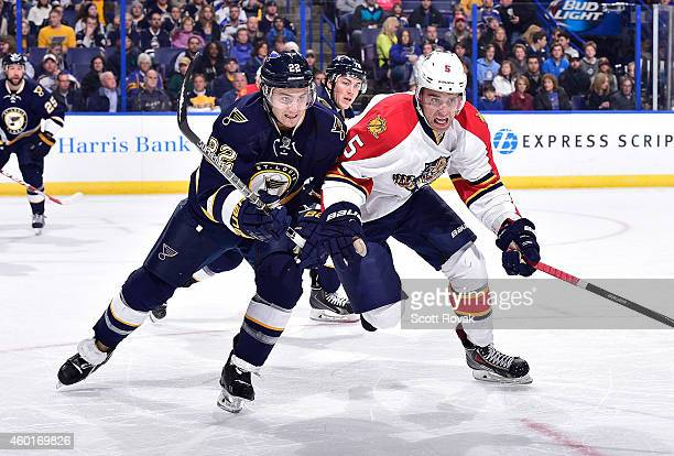 Kevin Shattenkirk of the St Louis Blues skates against Aaron Ekblad of the Florida Panthers on December 8 2014 at Scottrade Center in St Louis...