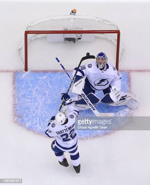 Kevin Shattenkirk of the Tampa Bay Lightning bats the puck clear of the goal area as goaltender Andrei Vasilevskiy of the Tampa Bay Lightning eyes...