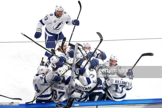 Kevin Shattenkirk of the Tampa Bay Lightning is congratulated by his teammates after scoring the gamewinning goal during the first overtime period to...