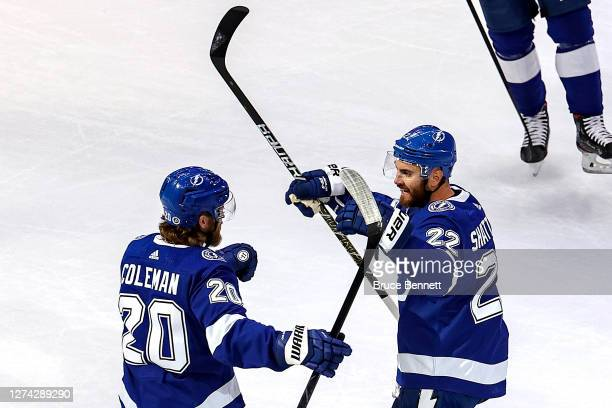 Kevin Shattenkirk of the Tampa Bay Lightning is congratulated by Blake Coleman after scoring a goal against the Dallas Stars during the first period...