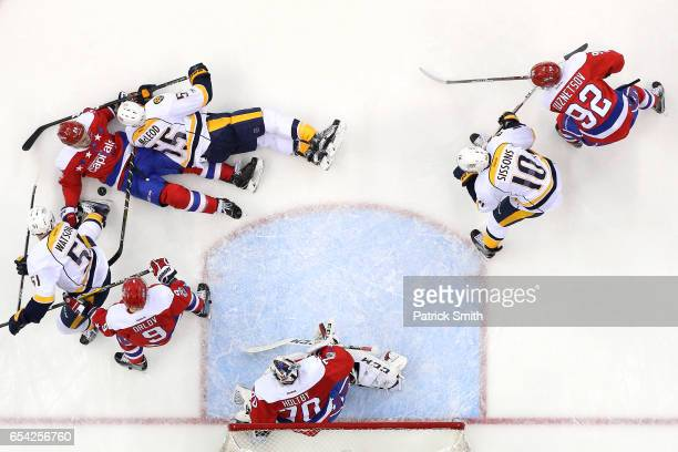 Kevin Shattenkirk of the Washington Capitals and Cody McLeod of the Nashville Predators battle for the puck during the second period at Verizon...
