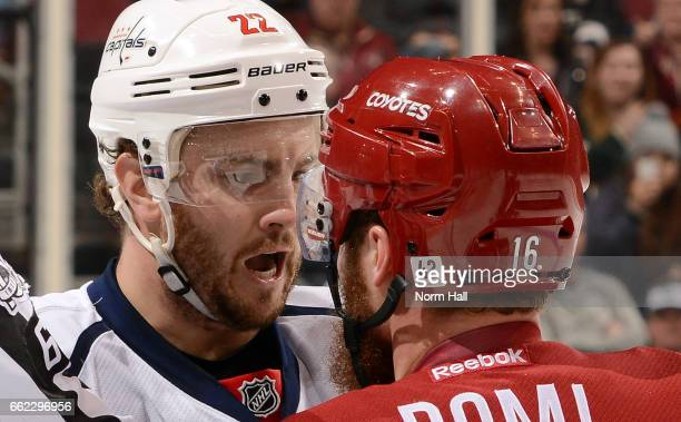 Kevin Shattenkirk of the Washington Capitals and Max Domi of the Arizona Coyotes exchange words during the first period at Gila River Arena on March...