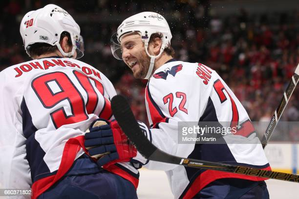Kevin Shattenkirk of the Washington Capitals congratulates teammate Marcus Johansson after a goal against the Colorado Avalanche at the Pepsi Center...