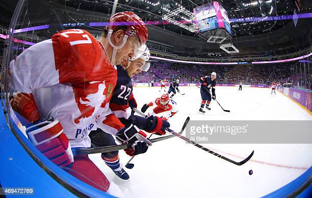 Kevin Shattenkirk of United States handles the puck against Alexei Tereshchenko of Russia in the first period during the Men's Ice Hockey Preliminary...